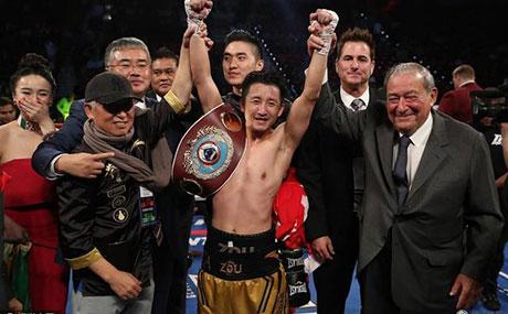 邹市明完成超级全满贯中国拳击产业链需完善