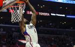 NBA常规赛:快船主场胜热火